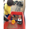 He has learnt how to fill the sand truck.