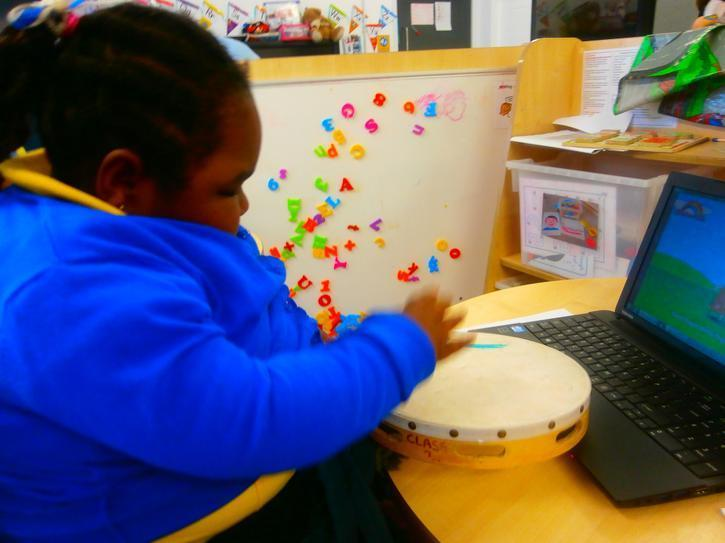 Eva playing the drum to the counting songs