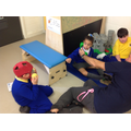 Callum, Zinet and Jack playing with John in class
