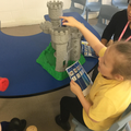 Liliana enjoying playing with the castle and little people