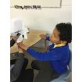 Kallum practising his scissor skills
