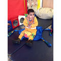 Eslam is able to sit unaided on the floor and can move his head to look around.