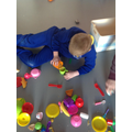 Alfie began to play independently with the toys.