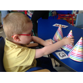 Zac using party hats to match numerals