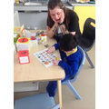 """The tower fell and Brandon communicated """"oh no!"""" using the core words board!"""