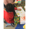 Jack printing with fruit in a creative session