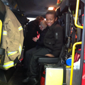The children sat together in the fire engine.