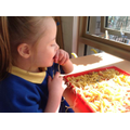 Sian exploring the pasta with her mouth