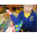 Callum using a finger & thumb movement to thread