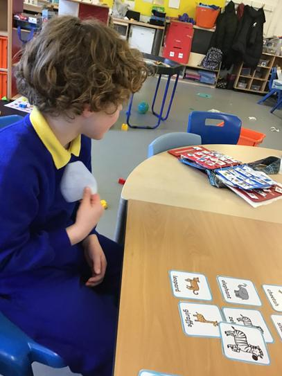 Tommy enjoys matching games and shows confidence when engaging.