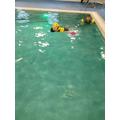 Ellis can swim on his back.