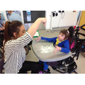 Emily enjoying sensory mark making in flour