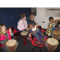 Children playing the drums as a group