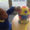 Sange playing with the shape sorter