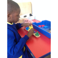 Colour sorting and developing fine motor skills
