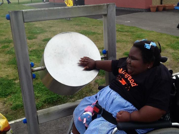 Eva banging the drum