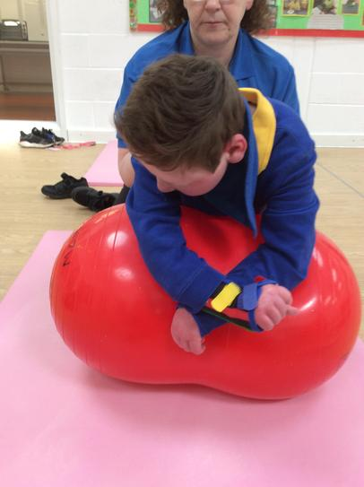 12/5 Joe going over a roll to help him develop four point kneel