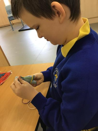 Austin was independent using a pincer gip to take the elastic band off the hippo.