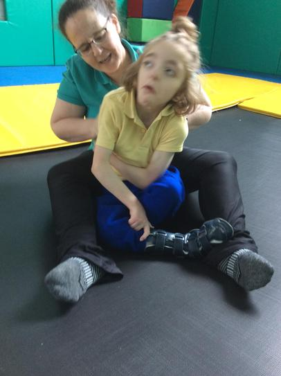 12/5 Matthew fully supported in asitting positon and enjoying the trampoline