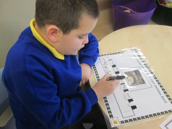 Joseph writing sentences from his favourite story