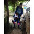 Emily exploring the allotment in her walker.