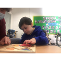 Brandon explored all the shapes when completing the jigsaw.
