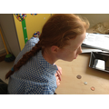 Poppie sorted her coins in 1p, 2p and 5p.