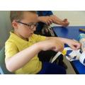 Alex getting involved in paper maching