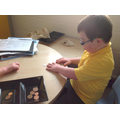 He looked at each coin carefully.