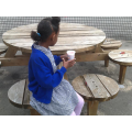 She sat at the picnic table to drink her smoothie