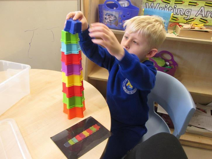 Callum using a visual cue to independently build