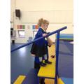 Millie practicing walking up the trampoline steps