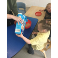 Grace joining in with cookery in class