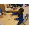 Remario exploring flour, water and cars with Sally