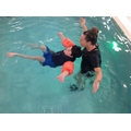 Jack floating independently in swimming