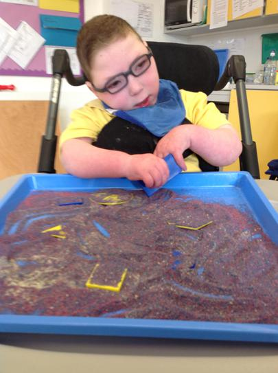 Looking for shapes in sand.
