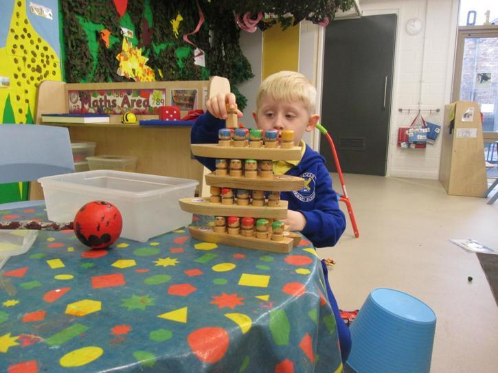 Callum independently building a tower