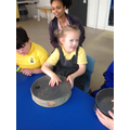 Liliana enjoying banging the drum in music