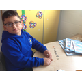 Mustafa working with coins up to £1.
