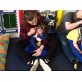 Emily supported sitting during sensory story