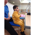 Eslam is learning to sit on a bench without prompts.