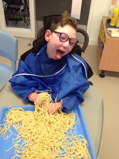 Joe explored spaghetti like hair with his hands