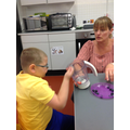 Callum added the fruit to the mixer to make smoothies in cookery