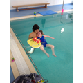 Amelia enjoying her swim with the Physio's.