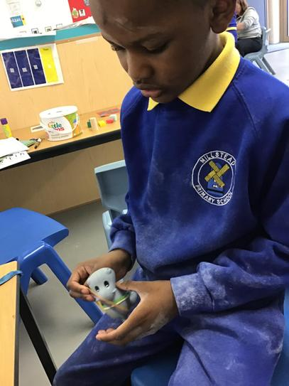 Eze was independent using a pincer grip to take elastic band off the hippo.
