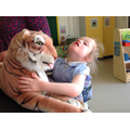 Sian following an adults lead to stroke the tiger