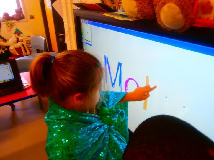 Molly practising her letter formation