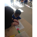 Ahmed making a flower out of playdough.