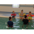 The children sitting for humpty dumpty in swimming