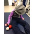 Alisha exploring jugglers props.